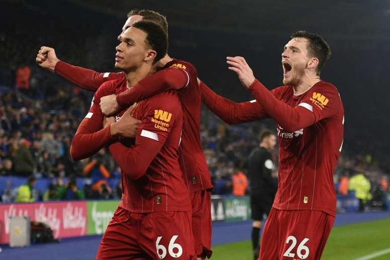 Alexander-Arnold préfère Henderson à CR7et Messi. AFP