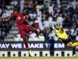 Ali (L) helped Qatar thrash Afghanistan in World Cup qualifying. AFP