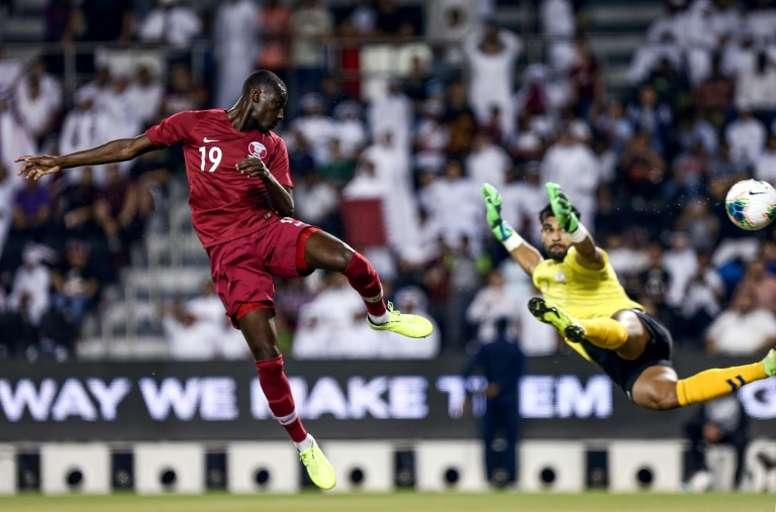 Ali (L) helped Qatar thrash Afghanistan in World Cup qualifying. AFP