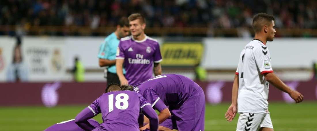 Real Madrid players celebrate a goal against Cultural y Deportiva Leonesa. AFP