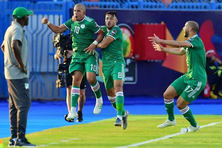 Feghouli (2L) scored Algeria's goal in their penalty shootout victory. AFP