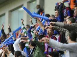 Eibar fans celebrate during a match at the Ipurua stadium in Eibar on May 31, 2014