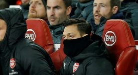 Mesut Ozil was left out again this evening as Arsenal lose to BATE. AFP