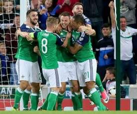 Northern Ireland's defender Jonny Evans (C) celebrates scoring during a World Cup qualifier. AFP