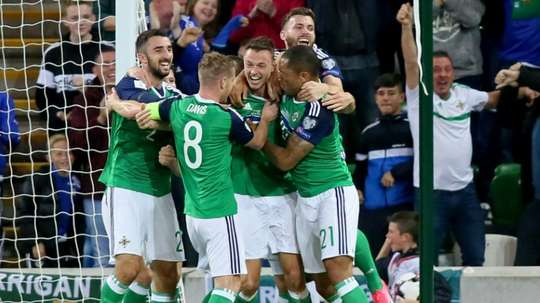 Northern Ireland's defender Jonny Evans (C) celebrates scoring during a World Cup qualifier. AFP