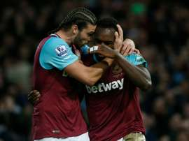 West Ham Uniteds midfielder Michail Antonio celebrates with striker Andy Carroll (L) after scoring their first goal during the English Premier League football match against Southampton in Upton Park, in east London on December 28, 2015
