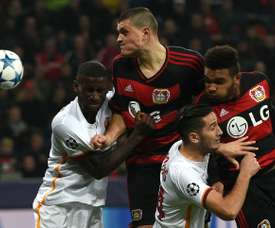 Leverkusens Kyriakos Papadopoulos and Jonathan Glao Tah (R) vie with Roma´s Antonio Ruediger (L) and Kostas Manolas during the Group E, first-leg UEFA Champions League football match in Leverkusen, western Germany on October 20, 2015