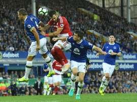 Jagielka challenges Boro's Alvaro Negredo in Everton's 3-1 win on Saturday. AFP
