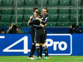 Real Madrid players celebrate after Gareth Bale (R) scored against Legia Warsaw. AFP