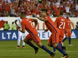 Chiles Alexis Sanchez (L) celebrates with teammate Eduardo Vargas after scoring against Panama during their Copa America Centenario match, in Philadelphia, Pennsylvania, on June 14, 2016