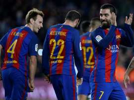 Barcelonas Turkish midfielder Arda Turan (R) celebrates after scoring during the Spanish Copa del Rey (Kings Cup) round of 32 second leg football match FC Barcelona vs Hercules CF at the Camp Nou stadium in Barcelona on December 21, 2016