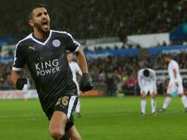 Leicester Citys Algerian midfielder Riyad Mahrez celebrates after scoring his third goal during a match against Swansea City Stadium in Swansea, south Wales on December 5, 2015