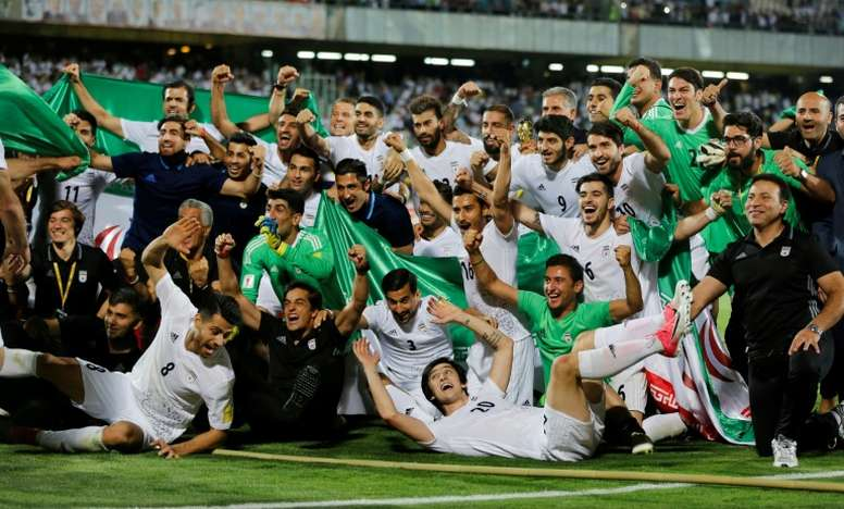 Iranian players celebrate after winning the 2018 World Cup. AFP
