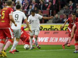 Gnabry (C) got a brace in Bayern's 1-4 win at Cologne. AFP