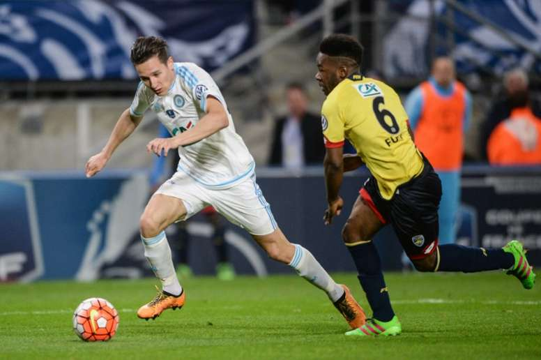 Marseille midfielder Florian Thauvin (L) vies with Sochaux defender Jeando Fuchs during the French Cup semi-final match in Montbeliard on April 20, 2016