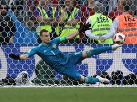 Akinfeev saved two penalties to send Russia through. AFP
