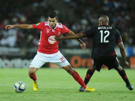 Orlando Pirates Lehlogonolo Masalesa (R) vies with Etoile du Sahels Mohamed Amine Ben Amor during the first final of the 2015 CAF - Confederation of African Football Cup match on November 21, 2015 at the Orlando Pirates Stadium in Johannesburg