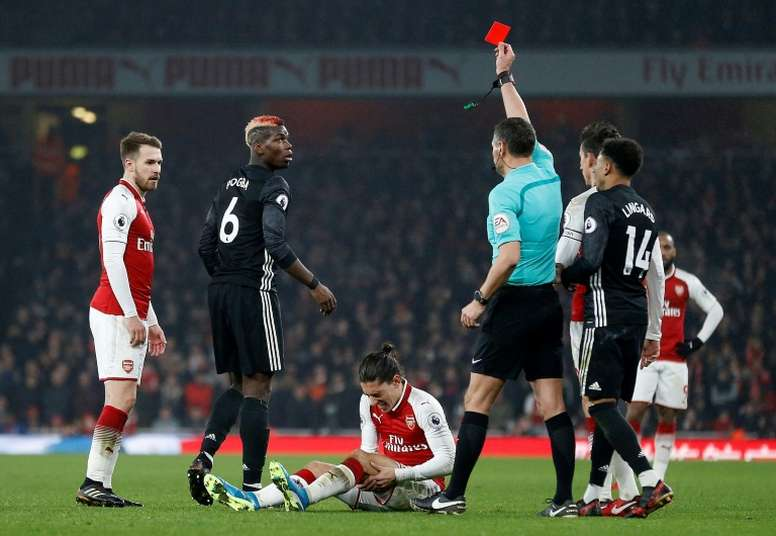Paul Pogba saw red when the two sides met at the Emirates. AFP