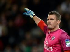 French goalkeeper Douchez handed fine after drunken rampage. AFP