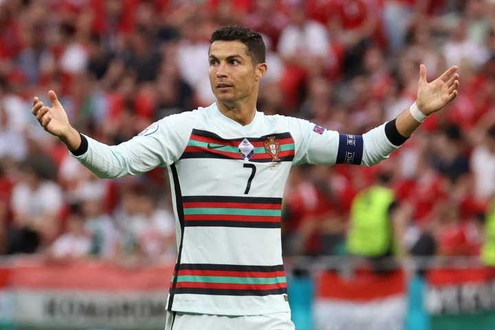 UEFA are investigating insults aimed at CR7, Mbappe and Benzema in Budapest. AFP