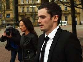 Former Sunderland footballer Adam Johnson (R) and his former girlfriend Stacey Flounders (L) leave Bradford Crown Court in Bradford, England, on February 29, 2016