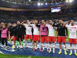 Three regional clubs in Germany are in trouble after their players' military salutes. AFP