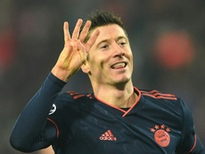 Lewandowski makes history with four goals in 15 minutes. AFP