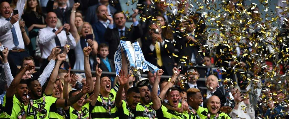 Huddersfield extend contracts with three players. AFP