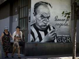 Street portraits are sprinkled across the city in Belgrade. AFP