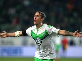 Wolfsburg's striker Max Kruse celebrates after scoring. BeSoccer