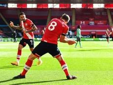 Southampton goal-scorer James Ward-Prowse (C) celebrates with Danny Ings (L). AFP