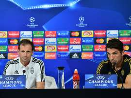 Juventus coach Massimiliano Allegri (L) and Juventus goalkeeper Gianluigi Buffon attend a press conference on the eve of the Champions League football match Juventus vs Sevilla FC at the Juventus Stadium  on September 29, 2015 in Turin