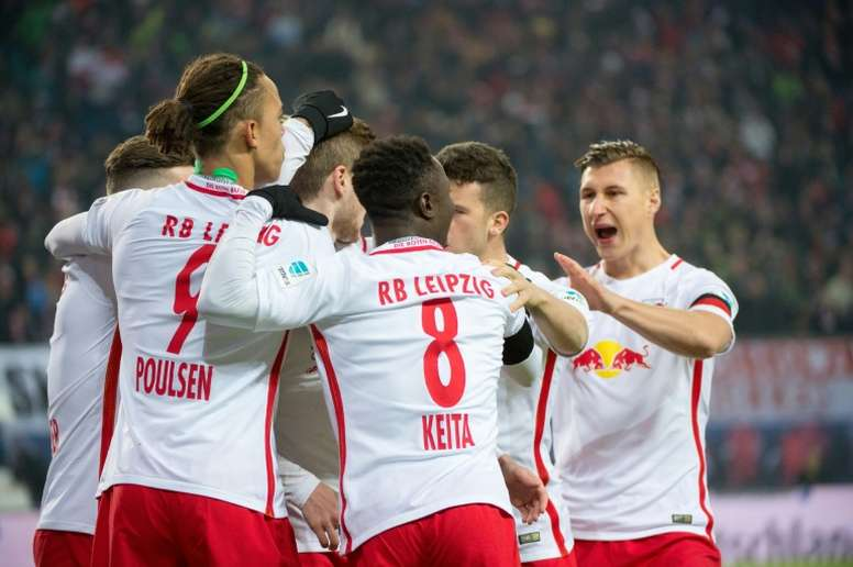 Players of RB Leipzig celebrate after scoring a goal during their German first division Bundesliga match against Schalke 04, in Leipzig, on December 3, 2016