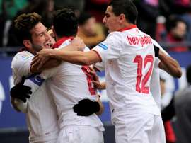 Sevilla players celebrate after their team scored the third goal against Osasuna. AFP
