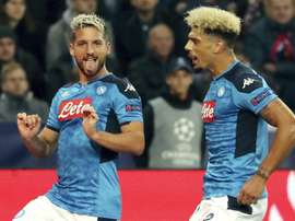 Mertens' double helped Napoli win by the odd goal in five in Austria. AFP