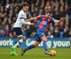 McArthur pictured up against Tottenham's Dele Alli. AFP