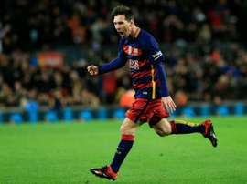 Barcelonas forward Lionel Messi celebrates after scoring during the Spanish Copa del Rey round of 16 first leg football match FC Barcelona vs RCD Espanyol at the Camp Nou stadium in Barcelona on January 6, 2016