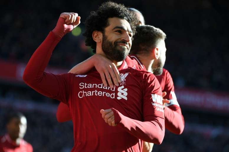 Mo Salah celebrates scoring the opening goal in Liverpool's 4-1 win over Cardiff at Anfield. AFP