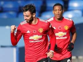 Manchester United midfielder Bruno Fernandes celebrates his equaliser against Everton. AFP