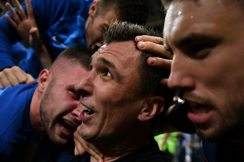 AFP photographer becomes part of Croatia World Cup goal celebration. AFP