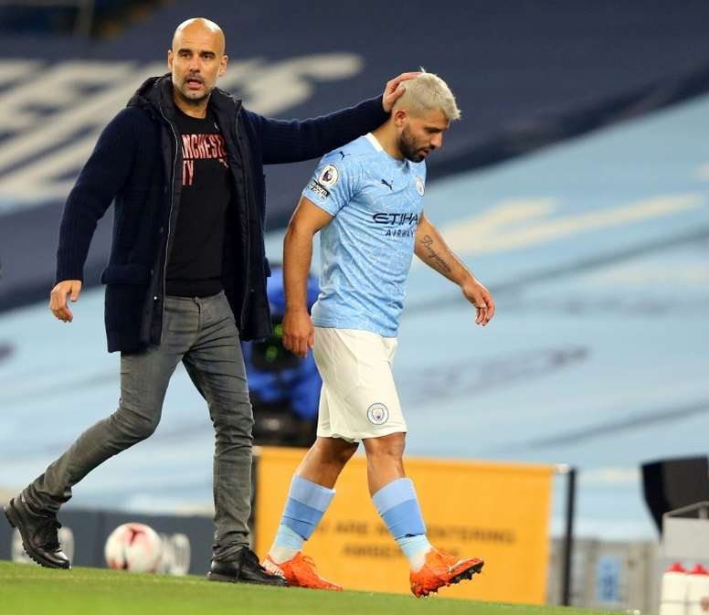 Sergio Aguero (R) put his arm around the female assistant while contesting a decision. AFP
