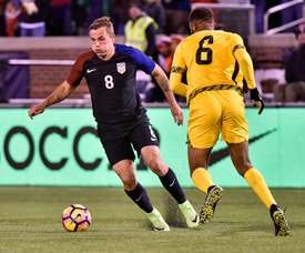 Jordan Morris (L) of the US fights for the ball with Sergio Campbell of Jamaica. AFP