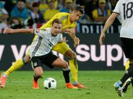 Germanys forward Mario Goetze (centre) vies with Ukraines defender Yevhen Khacheridi during their Euro 2016 match at the Stade Pierre Mauroy in Villeneuve-dAscq on June 12, 2016
