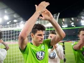 Wolfsburgs forward Mario Gomez celebrates after the Bundesliga Relegation first-leg football match