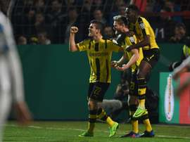 Dortmund set up semi-final against Bayern.