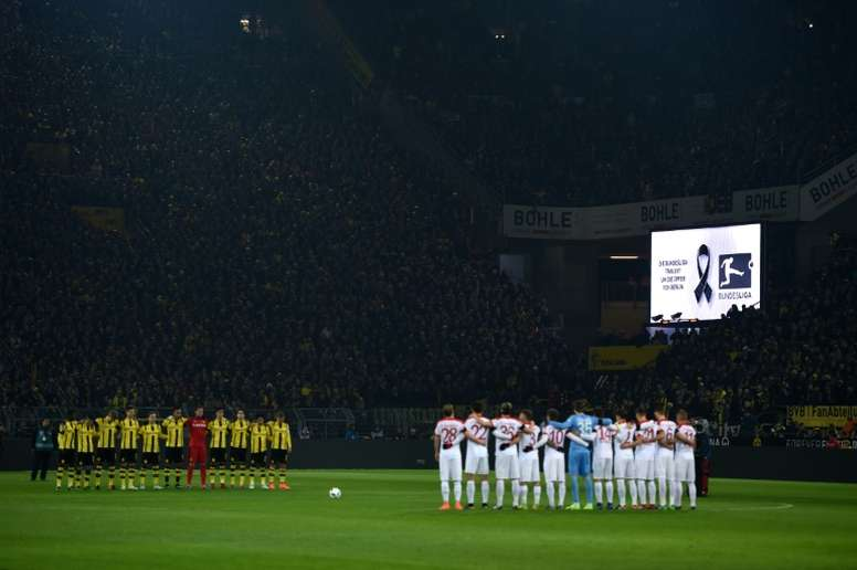 Dortmund and Augsburg players pay tribute to the victims of the recent attacks in Berlin. AFP