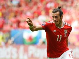 Wales forward Gareth Bale celebrates after scoring the first goal during the Euro 2016 group B football match between Wales and Slovakia at the Stade de Bordeaux in Bordeaux on June 11, 2016