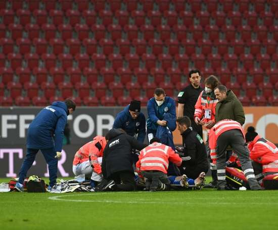Schalke forward Mark Uth receives medical treatment. AFP
