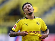 Sancho needs to be 'more grown up', says Dortmund teammate Can after haircut row. AFP