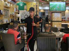 Iraqis buy into World Cup fever, without breaking the bank. AFP
